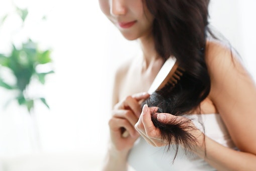 Detangle Frizz-Prone Hair With a Paddle Brush